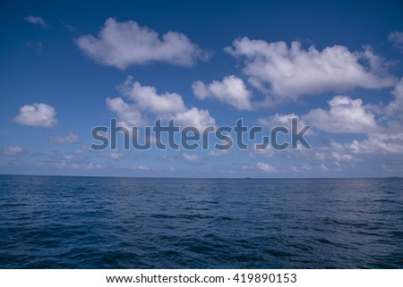 Blue Skyline and Cloud at Maldive, Over India Ocean, Sky clouds, Blue sea, Blue sea water surface on sky, The vast blue sky and clouds sky, Sky in soft clouds, Fluffy sky background, Sky cloudy white - stock photo
