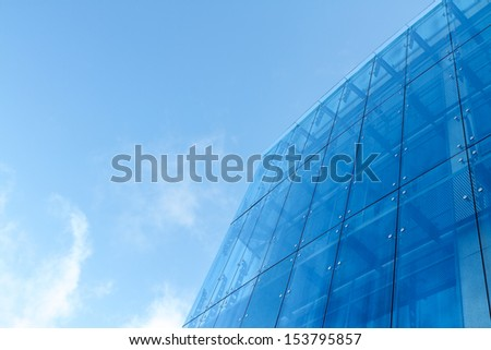 Blue skyscraper facade - stock photo
