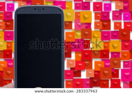 Blue smartphone and blister heart shapes. Idea for Valentines Day messages, love, lovers, love apps, Internet, blogs and others. - stock photo