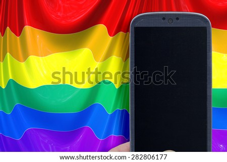 Blue smartphone and LGBT flag background. Idea for Valentines Day messages, LGBT love, lovers, love apps, Internet, blogs and others. - stock photo