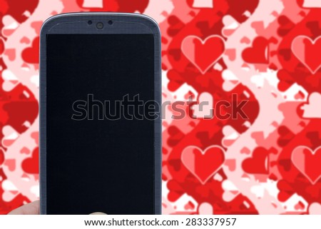 Blue smartphone and love wallpaper. Idea for Valentines Day messages, love, lovers, love apps, Internet, blogs and others. - stock photo