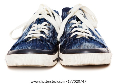 Blue sneakers on white background - stock photo