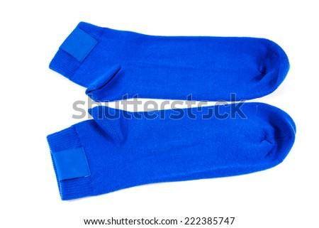 Blue socks on white background - stock photo