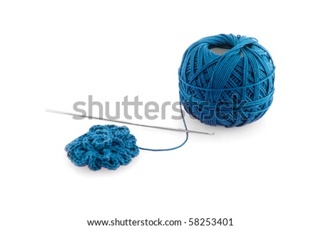Blue spool and needle on a white background. - stock photo