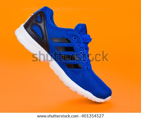 Blue Sport shoes. Running shoes on an orange background - stock photo
