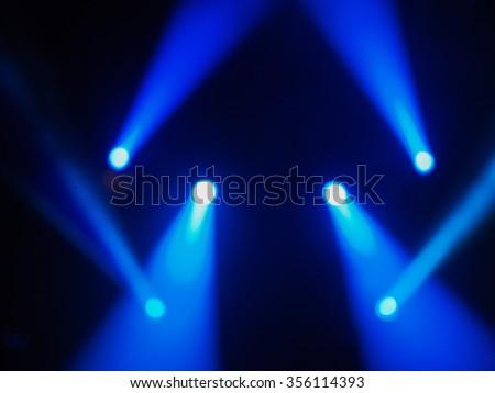 Blue spot lights at a concert - stock photo
