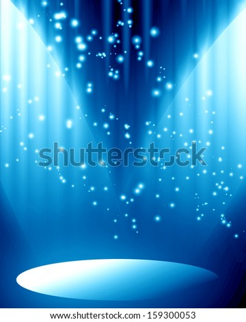 blue spotlight with some glitter and sparkle on it - stock photo