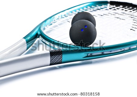 Blue squash racket with balls on white background - stock photo