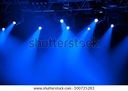 Blue stage spotlights - stock photo