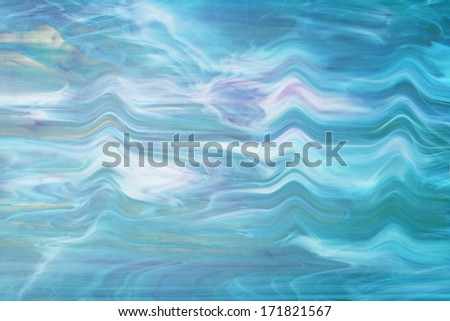 Blue stained opalescent glass  - stock photo
