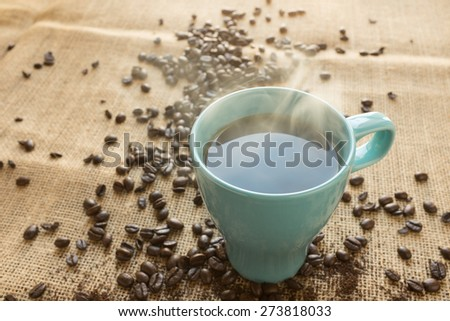 Blue steaming coffee cup - stock photo