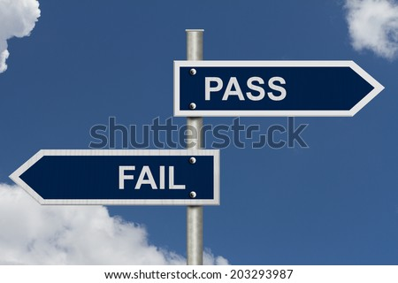 Blue street signs with blue sky with words Pass and Fail, Pass versus Fail - stock photo