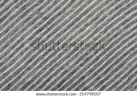 Blue striped background. Blue and white diagonal stripes pattern on fabric. - stock photo