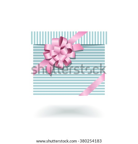 Blue striped gift box with pink bow isolated on white background - stock photo