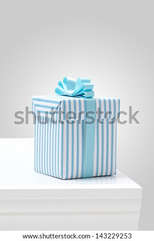 blue striped pattern gift box on white table. Gift boxes with blue ribbon.  - stock photo