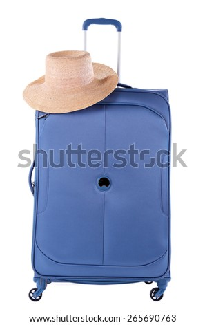 Blue suitcase with hat isolated on white - stock photo