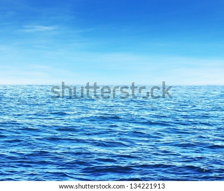 Blue sunny sea water surface - stock photo