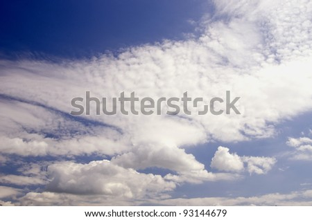 Blue sunny sky full of clouds. Beautiful view. - stock photo