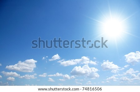 Blue sunny sky with small clouds - stock photo