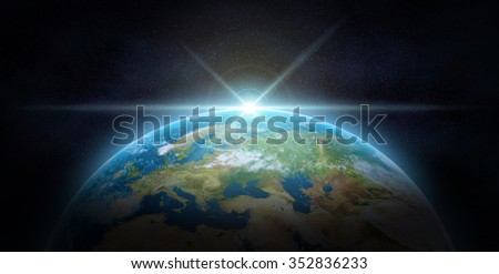 Blue sunrise, view of earth from space.The Earth texture of this image furnished by NASA. - stock photo