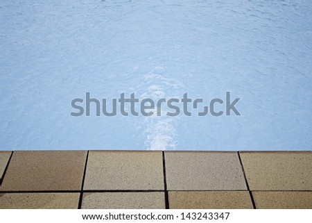 Blue swimming pool with light reflections on recreational resort, vacation - stock photo