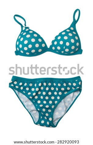 Blue swimsuit with polka dots. Isolate on white. - stock photo