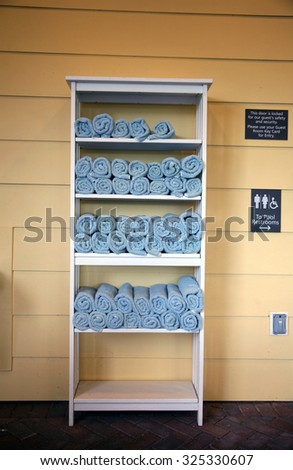 Blue Terry Cloth Beach or Pool Towels fresh from the wash ready to be used. Terry cloth towels are used because they are so absorbent and easily dry off wet people, pets, children and spills.  - stock photo