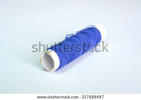 Blue thread  isolated on white background - stock photo