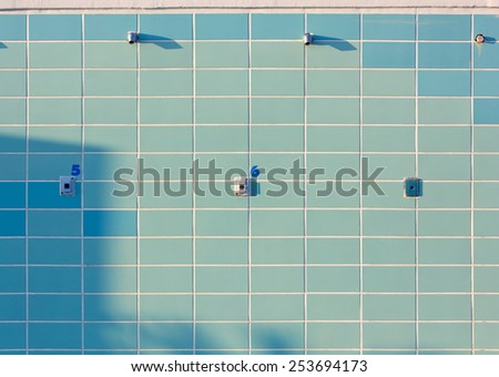 Blue Tiled Numbered Outdoor Beach Showers - stock photo