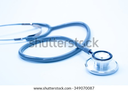 Blue tint stethoscope isolated on white - stock photo