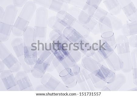 blue toned transparent edible pills - stock photo