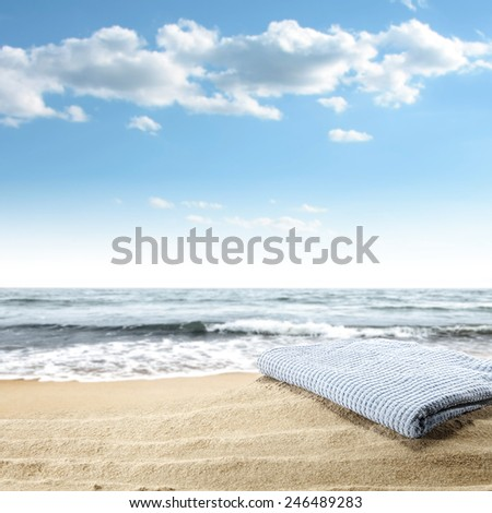 blue towel and sand  - stock photo