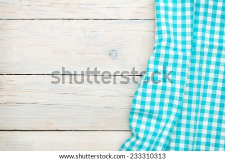 Blue towel over wooden kitchen table. View from above with copy space - stock photo