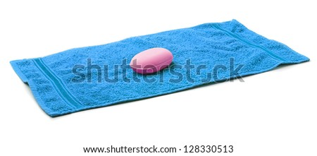 Blue Towel with bar of pink Soap. - stock photo