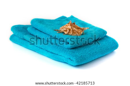 blue towel with seashell isolated on white - stock photo