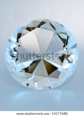 Blue transparent round gemstone, front view - stock photo