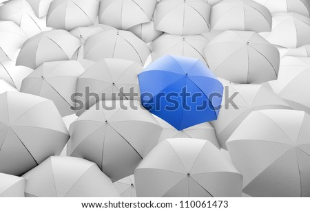 blue umbrella among white umbrellas - stock photo