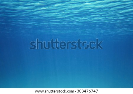 Blue underwater surface and ripples, natural scene in the Caribbean sea - stock photo