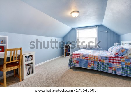 Blue vaulted ceiling room with carpet floor. Furnished with a white bed, bookshelf, desk - stock photo
