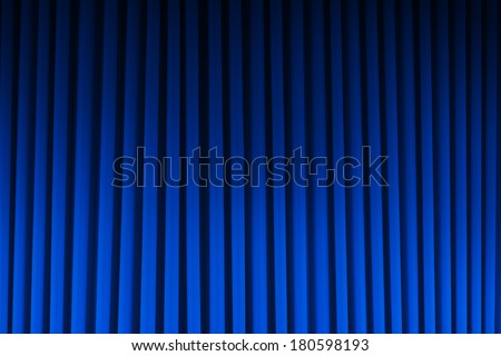 Blue Velvet Theater Curtain Dim Lite Background. - stock photo