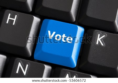 blue vote button on computer keyboard showing internet concept - stock photo