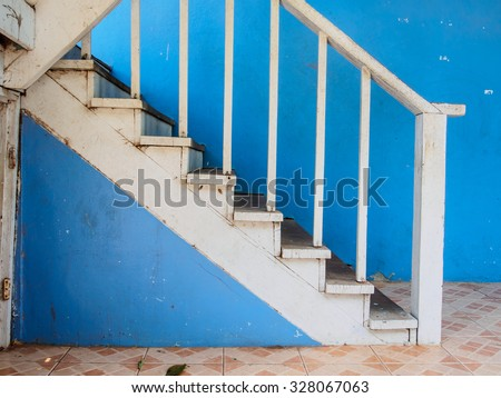Blue wall and stair for step - stock photo