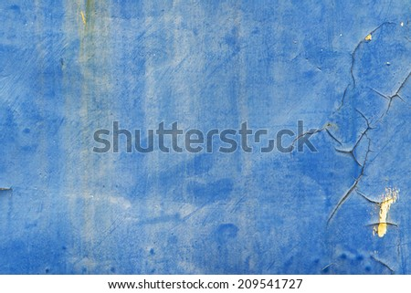 Blue wall background, some have rust corrosion cracks - stock photo