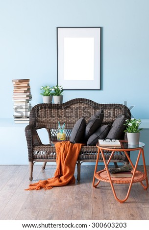 blue wall interior concept and wicker furniture - stock photo