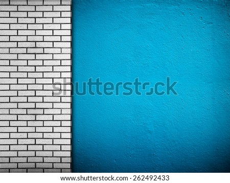 blue wall with brick background - stock photo