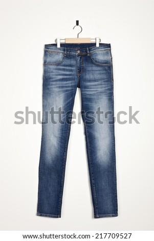 blue washing denim pants trousers isolated white. - stock photo
