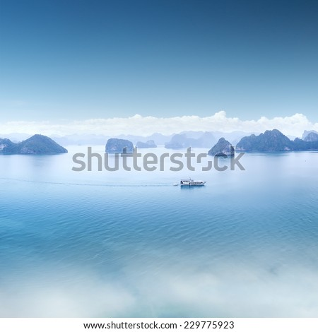 Blue water and sky aerial view panorama of Halong Bay in Vietnam. Scenic background landscape  - stock photo