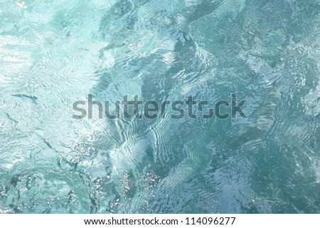 blue water background clear pure and transparent with waves - stock photo