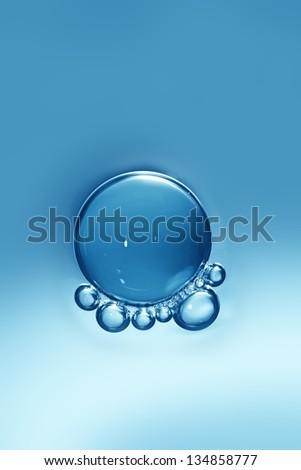 blue water bubbles abstract light illumination. - stock photo