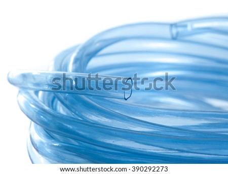 Blue water hose isolated on white - stock photo